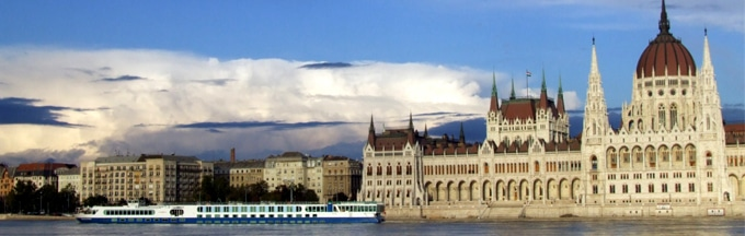 budapest parliament, water view, boat foreground, blue sky