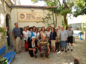 senior group photo in front of lifeline for the old in israel