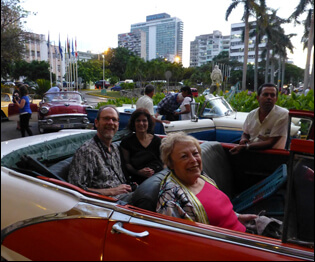 cuba tours, classic red car with tourists