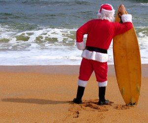 SANTA CLAUS LOOKING FOR THE PERFECT WAVE